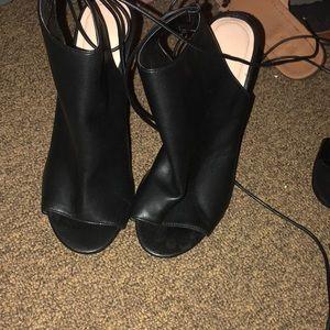 Black leather peep toe booties